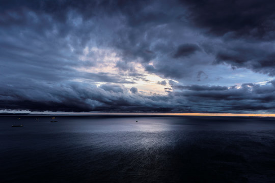Dramatic panoramic view of the sea and moody cloudy sky