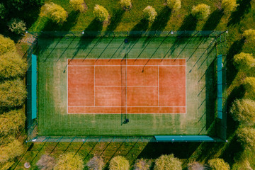 tennis field in the forest at sunset