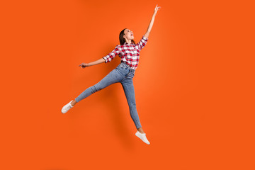 Full size length body photo of attractive charming pretty beautiful charming gorgeous woman jumping up pointing on highest top isolated vibrant color background