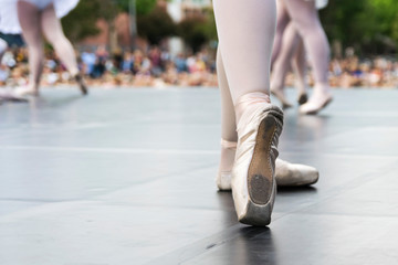 Dancers in a street show, detail of dance shoes - image