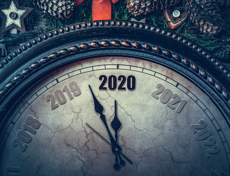 On the New Year's clock 2020. The old clock points to two thousand and twenty arrows.