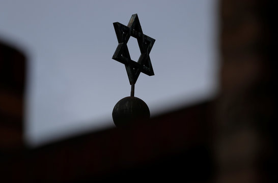 The Star of David is seen at the dome of the synagogue in Halle