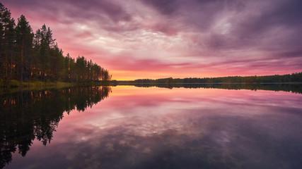 Rose sunset colors at the lake in Karelia