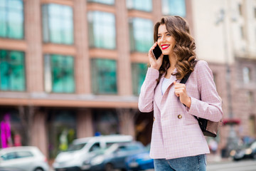 Fototapete - Portrait of her she nice-looking attractive charming winsome trendy cheerful cheery wavy-haired lady making call partner abroad discussing project startup on fresh air downtown center outdoors