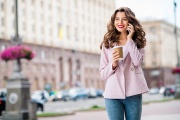 Fototapete - Portrait of her she nice-looking attractive charming lovely cheerful wavy-haired lady foreign tourist calling home adventure discussing in downtown center outdoors