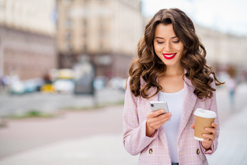Fototapete - Portrait of her she nice-looking attractive charming winsome lovely cheerful cheery wavy-haired businesslady traveling using 5g app web service in town center outdoors