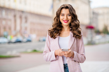 Fototapete - Portrait of her she nice-looking attractive charming glamorous lovely adorable cheerful cheery wavy-haired lady holding in hands phone using gps navigation map rout service in park outdoors