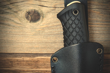 part of hunting knife in a leather scabbard