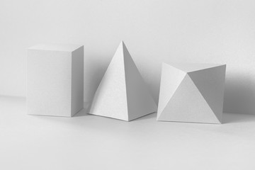 Geometrical figures still life composition on white. Beautiful three-dimensional pyramid rectangular cube objects. Platonic solids figures, simplicity concept photography Wall mural