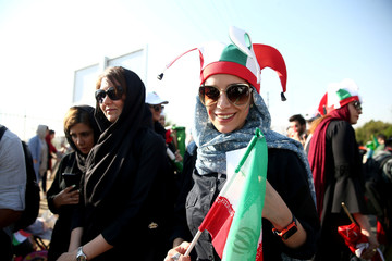 Iranian women fans arrive to attend Iran's FIFA World Cup Asian qualifier match against Cambodia, as for the first time women are allowed to watch the national soccer team play in over 40 years, at the Azadi stadium in Tehran