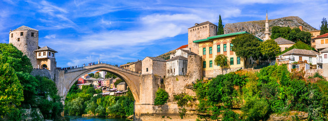 Photo Stands Old building Mostar - iconic old town with famous bridge in Bosnia and Herzegovina. popular tourist destination