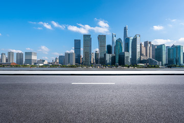 Wall Mural - road with city skyline