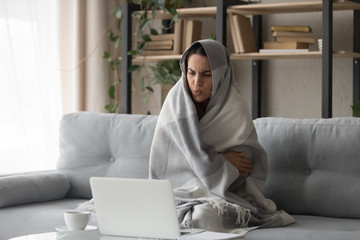 Sick woman feel cold at home covered with blanket