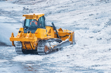 Powerful bulldozer for snow removal after snowfall.