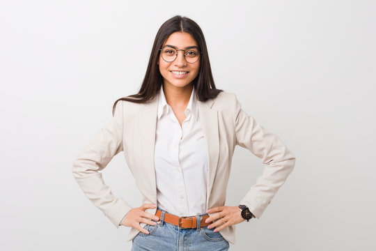 Young business arab woman isolated against a white background confident keeping hands on hips.