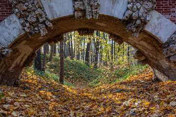View from under the old bridge to the autumn landscape, Tsaritsyno park in Moscow, Russia
