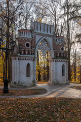 Grape gate in Neo-Gothic style in the landscape Tsaritsyno park in Moscow, Russia