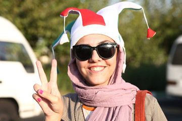 An Iranian woman gestures as she arrives to attend Iran's FIFA World Cup Asian qualifier match against Cambodia, as for the first time women are allowed to watch the national soccer team play in over 40 years, at the Azadi stadium in Tehran