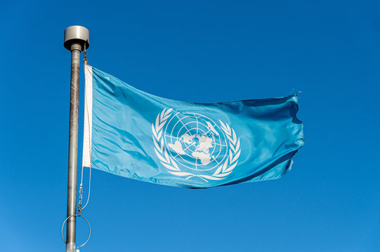 United Nations flag over blue sky