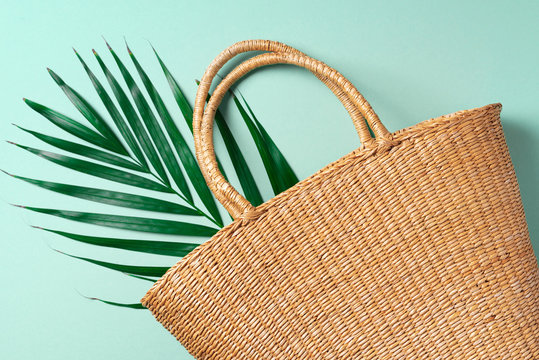 Handmade summer bag on trendy green background. Top view. Fashionable stylish accessory. Natural, organic, eco friendly, zero waste, plastic free concept.