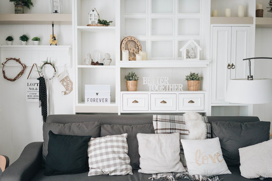 Home decor - Bright cosy comfy white living room with winter decorations for family or couple.
