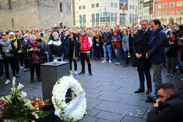 Mourners gather at the market square in Halle