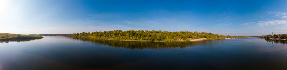 Foto op Canvas Bos rivier Panorama over the water surface to the autumn forest