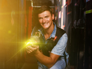 guy took aim colored laser guns during laser tag game