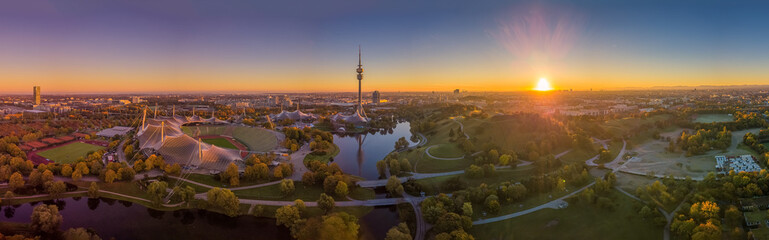 Impressive total view over Munich at sunset with the Olympic Park.