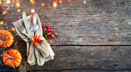 Thanksgiving Place Setting - Rustic Table With Silverware And Pumpkins