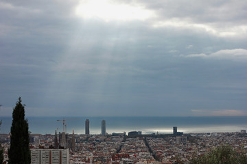 Sunlight through the clouds above Barcelona