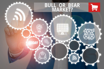 Text sign showing Bull Or Bear Market Question. Business photo showcasing asking someone about his marketing method Male human wear formal work suit presenting presentation using smart device