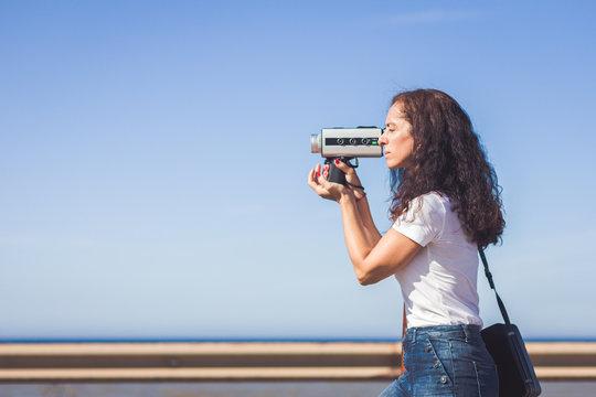 Filmmaker filming with a 8 mm film camera