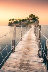 Obraz The sunrise at Agios Sostis Island, Cameo Island in Zakynthos, Greece. Wooden bridge. - fototapety do salonu