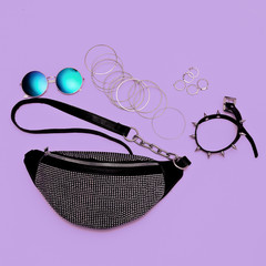 Stylish lady silver clutch and swag jewelry . Trendy Accessories flat lay fashion concept