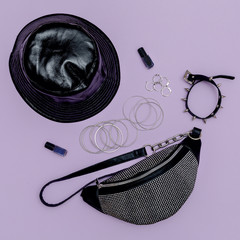 Stylish lady clutch and swag trendy jewelry . Girls Accessories flat lay fashion concept