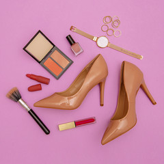 Fashion beige lady shoes and accessories. Trend cosmetics.  Stylish flat lay details