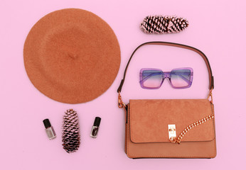 Stylish beige clutch and beret. Fall season flat lay concept