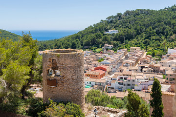 Old tower with historic city of Capdepera seen from Capdepera Castle located in the east of Majorca, Spain