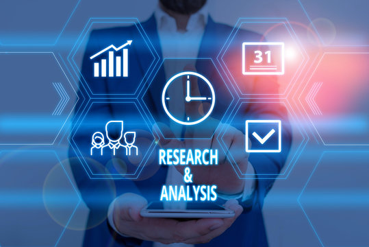 Text sign showing Research And Analysis. Business photo showcasing Strategic Thinking and Decision Making existing or new Male human wear formal work suit presenting presentation using smart device