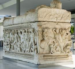 Ancient stone sarcophagus with battle scenes at the entrance of the Archaeological Museum of Thessaloniki Soldiers in battle Scene from foot of sarcophagus ancient macedonia greece