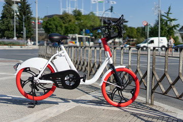 City bicycle Thessaloniki parked electric bike on the sidewalk ready for rent rental bikes services sharing service