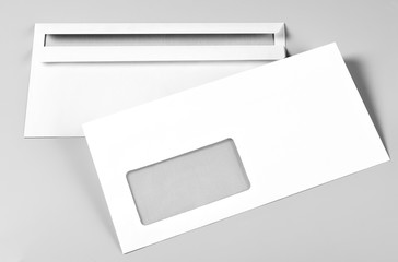 Two Blank Envelopes over Grey Background