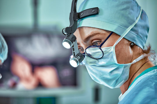 Female surgeon in operation room with reflection in glasses