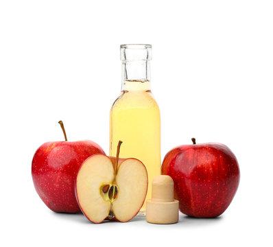 Bottle of apple cider vinegar on white background