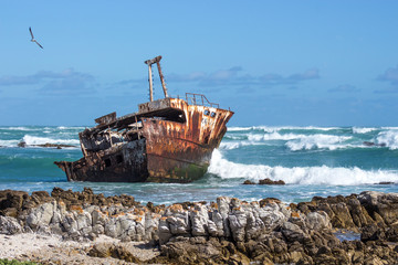 Tuinposter Schip old fishing boat in the sea