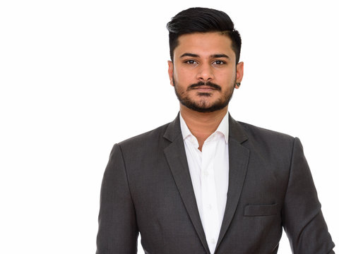 Young handsome Indian businessman isolated against white background