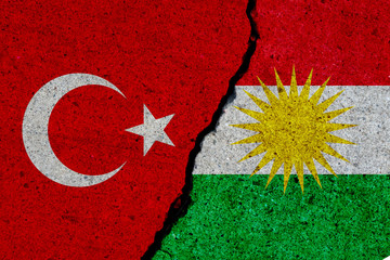 turkey and kurdistan flags painted over cracked concrete wall