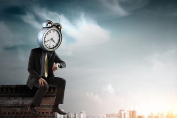 Clock headed businessman. Business efficiency concept.