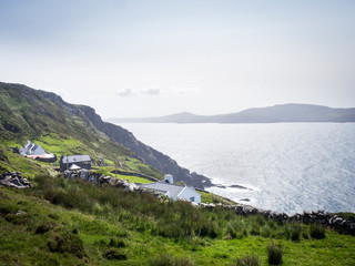 Coastline with buildings at sheeps head in ireland